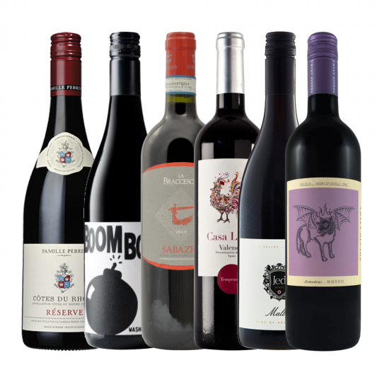 <p>These are the reds from where you'd rather be this Winter. We know you can't go anywhere so we're bring the world to you.&nbsp;</p><p>1 x Charles Smith 'Boom Boom' Syrah, Washington State, U.S.A<br>1 x Casa Lluch Tempranillo, Valenci, Spain<br>1 x Poggio Anima Asmodeus Nero D'Avola DOC, Sicily, Italy<br>1 x Fattoria La Braccesca Sabrazio Rosso Di Montepulciano, Tuscany, Italy<br>1 x Jed Malbec, Mendoza, Argentina<br>1 x Famille Perrin Cote Du Rhone Rouge Reserve, Rhone Valley, France</p>